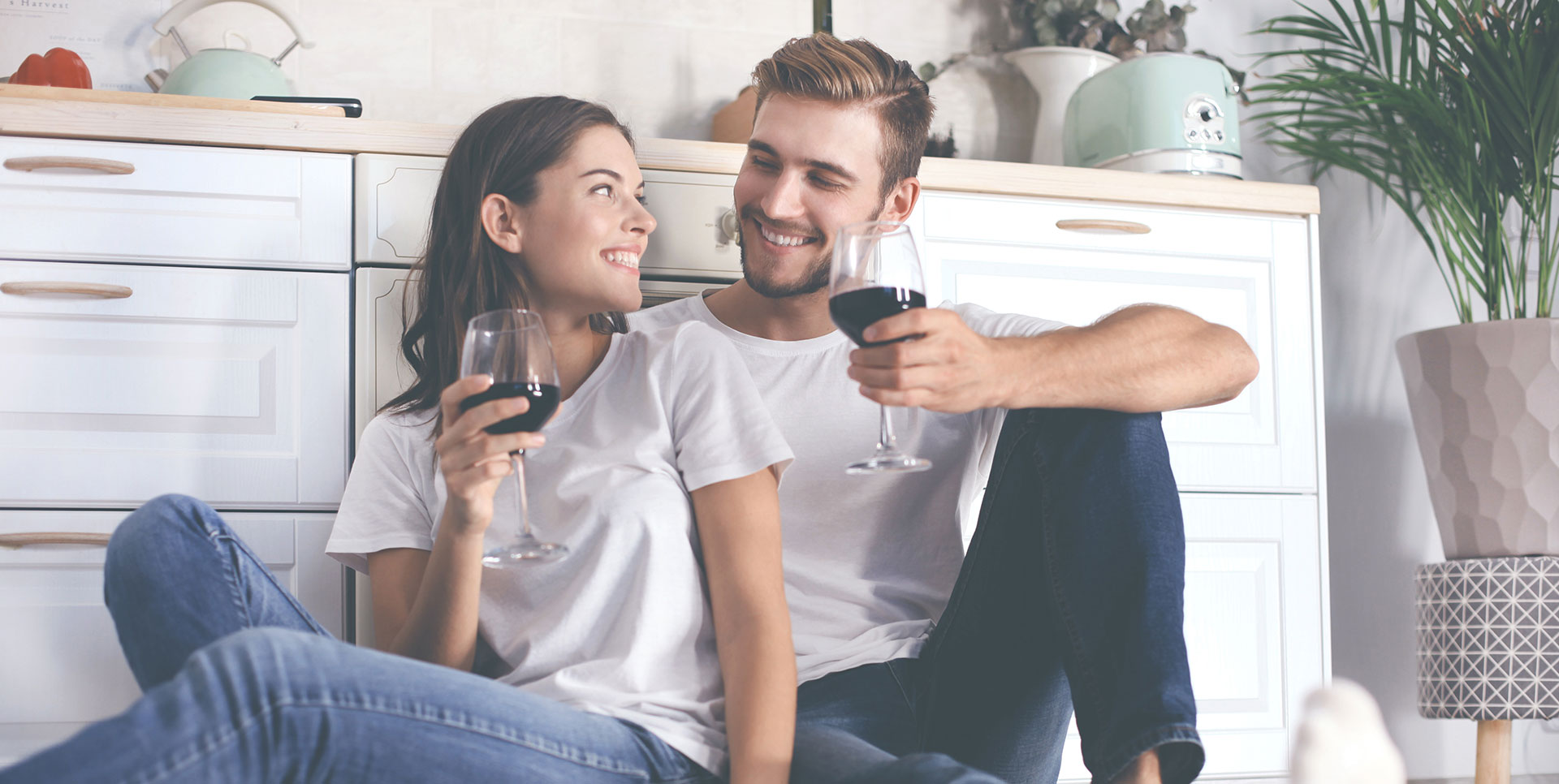 Couple enjoying wine after moving into their new home
